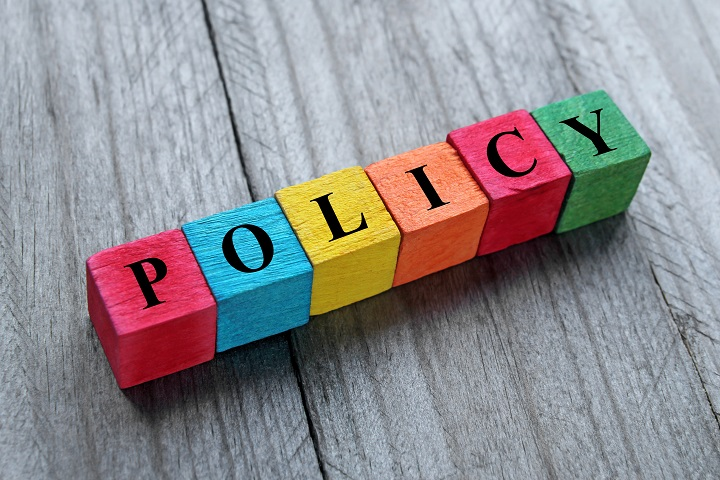 word policy on colorful wooden cubes